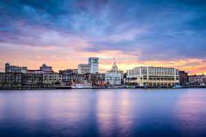 Savannah, Georgia, USA downtown skyline at the riverfront at dusk.