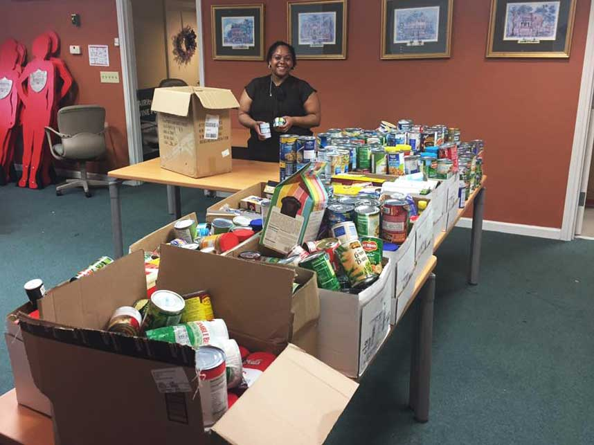 Boxes full of canned goods collected during food drive.