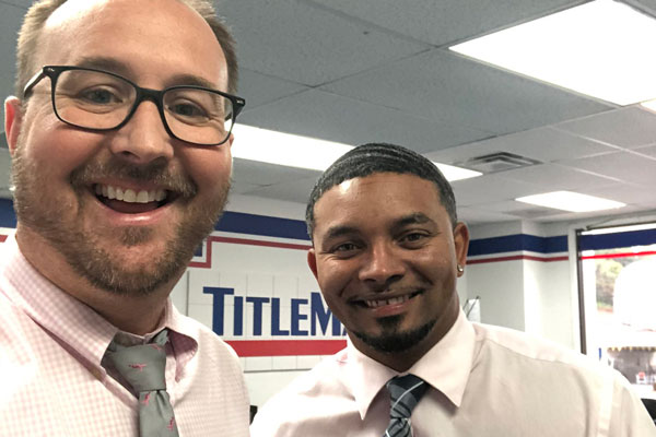 Two men in a TitleMax store