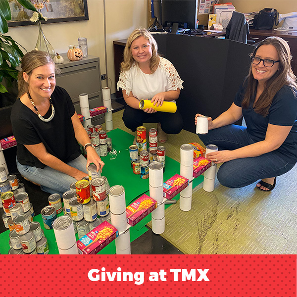 Women showing off canned food project